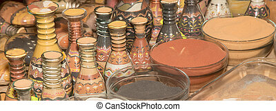 traditional local souvenirs in Jordan- bottles with sand and...