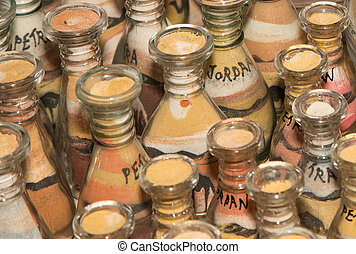 traditional local souvenirs in Jordan- bottles with sand and shapes of desert and camels