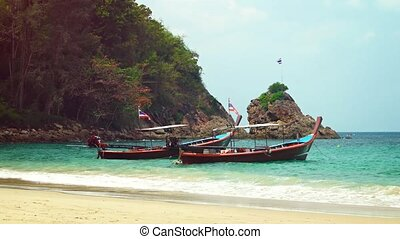 Traditional Long Tail Boats at a Tourist Beach in Thailand. Video