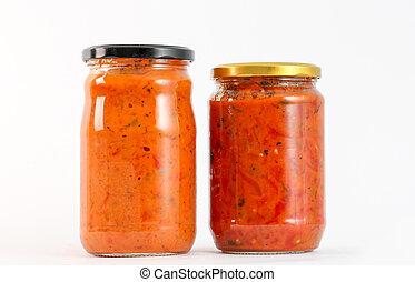 Traditional Macedonian food. Ajvar and lutenitza in jar . homemade product