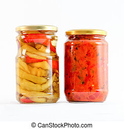 Traditional Macedonian food Luteniitza in jar and chilli paprika in jar. homemade product