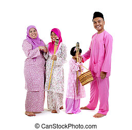 malay family - traditional malay family during hari raya...