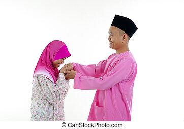traditional malay greeting during hari raya festival