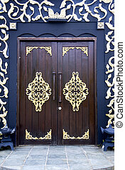 Ornate traditional Malay house doors.