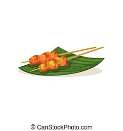 Traditional Malaysian snacks on wooden sticks. Appetizing...