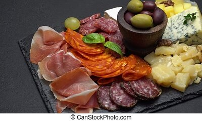 traditional meat and cheese plate - parmesan, meat, sausage...