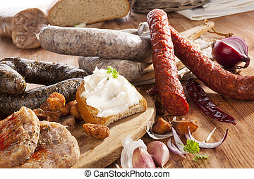 Traditional meat plate. - Various sausages, meat, bread with...