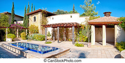 Traditional Mediterranean villa with courtyard and fountain