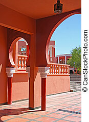 Traditional Moroccan architecture with ornate arches, in Marrakesh