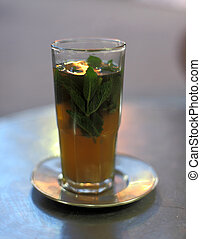 Traditional moroccan mint tea as served in a cafe in Tangier, Morocco