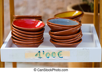 Traditional multi colored plates at the market in Santanyi town