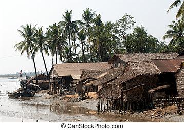Traditional Myanmar village on estuary in Kyaikto...