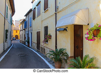 Traditional narrow street in the center of Rimini, Italy