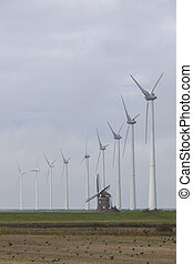 traditional old dutch windmill goliath and wind turbines...
