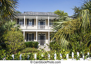 Traditional Old Two Story Behind Picket Fence