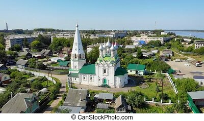 Drone perspective of Spasskaya Tserkov, a traditional orthodox church, with its onion domes and spires, in the town of Balakhna, Russia