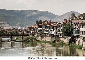River scene of old traditional Ottoman houses in Amasya, Turkey
