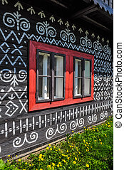 Traditional painted cottage wall and window detail
