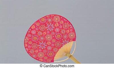 paper fan  - Traditional paper fan on gray background