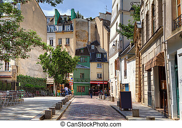Traditional parisian street. - View on narrow cobbled street...