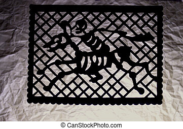 traditional perforated paper of a couple of a rider and horse