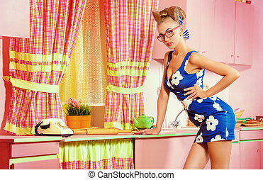 traditional pin-up - Pretty pin-up girl on a pink kitchen....