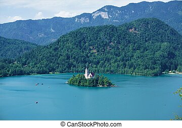Traditional Pletna boats around Bled island on lake Bled