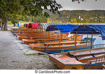 Traditional Pletna boats on beautiful lake Bled