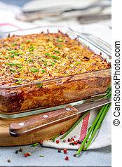 Traditional potato kugel gratin. - Potato kugel a...