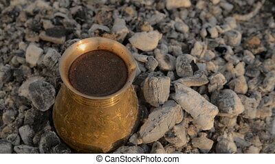 Traditional process boil Turkish coffee on coals. - Boil...