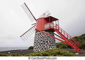 Traditional red and white windmill in Pico island, Azores. Portugal