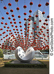 Traditional red lanterns and the modern abstract sculpture,