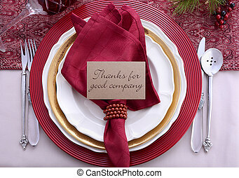 Traditional red theme Thanksgiving table place setting.