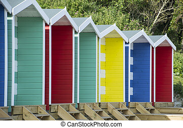 traditional row of colourful beach huts