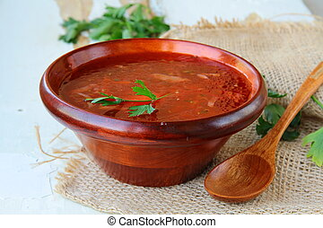 traditional Russian ukrainian borscht soup at a wooden table