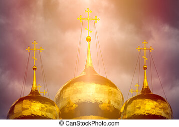Traditional russian church golden dome in sunlight