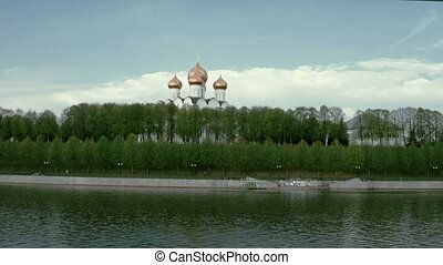 Traditional Russian Church on the river shore in spring in a daytime