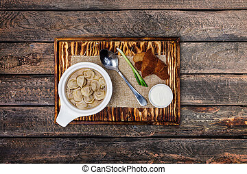 Traditional Russian pelmeni in a ceramic bowl.