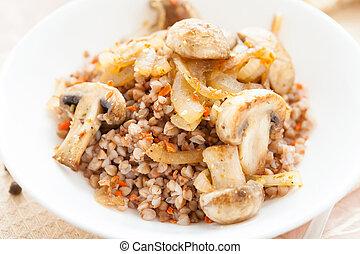 traditional Russian porridge with mushrooms, closeup