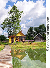 Traditional russian wooden baths at the bank of lake in summer sunny day