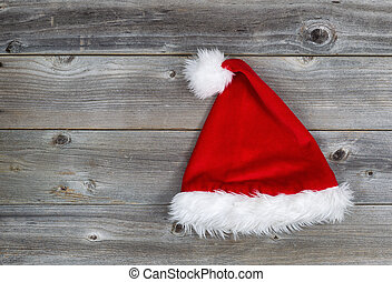 Traditional Santa Hat on Rustic Wood - Horizontal image of ...