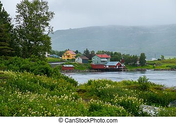 Traditional scandinavian houses near water in Norway