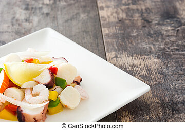 Traditional seafood ceviche from Peru on wooden table