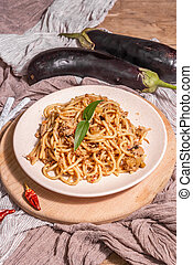 Traditional Sicilian pasta dish of sauteed eggplant topped with tomato sauce