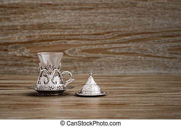 Traditional Silver Coffee Cup Set in a Tray on Wooden Background