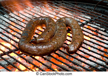 Traditional South African braai barbecue borewors sausage on fire
