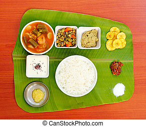 Traditional southern-indian meals on plantain leaf -...