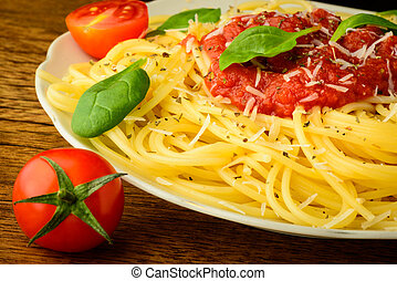 traditional spaghetti pasta with tomato sauce on a plate