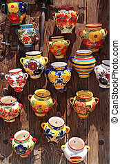 traditional spain ceramics pots - on the wooden door of souvenir shop