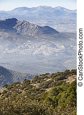 Traditional spanish rural village sorrounded by olive fields. Jaen